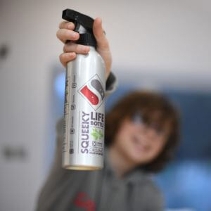 Child showing squeeky life bottle