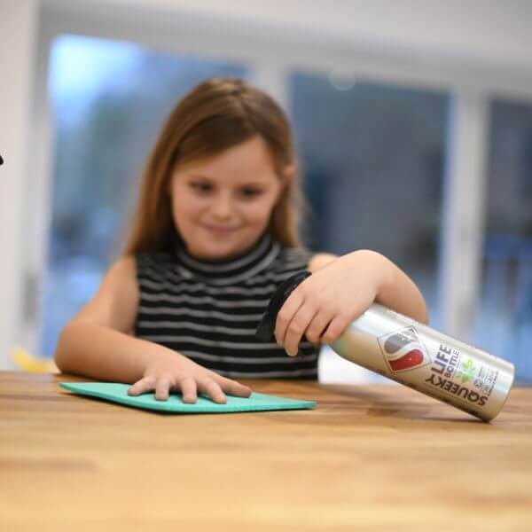 Child cleaning with squeeky life bottle